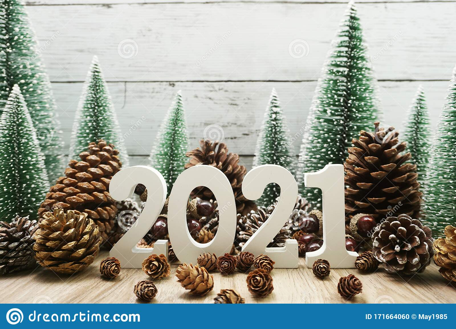 Christmas Tree Recolection 2021 2021 Happy New Year Festive Background With Christmas Tree And Pine Cone Decoration On Wooden Background Stock Photo Image Of Creative Celebrate 171664060