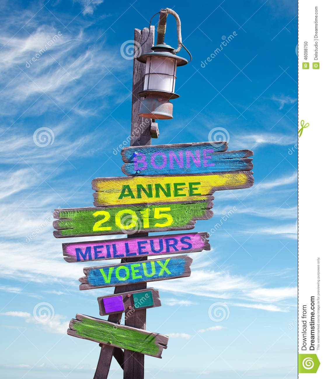 2015 happy new year in french on pastel colored wooden direction signs