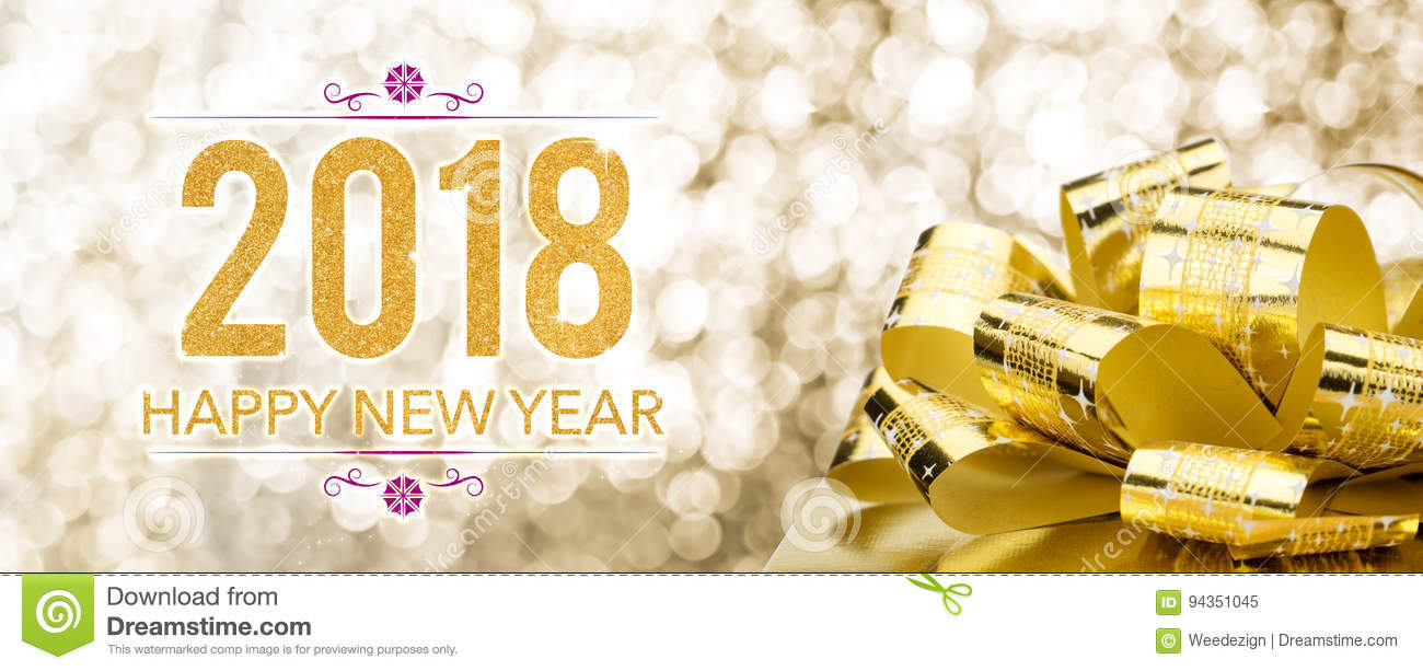 Happy new year 2018 with golden gift box with big bow at sparkli