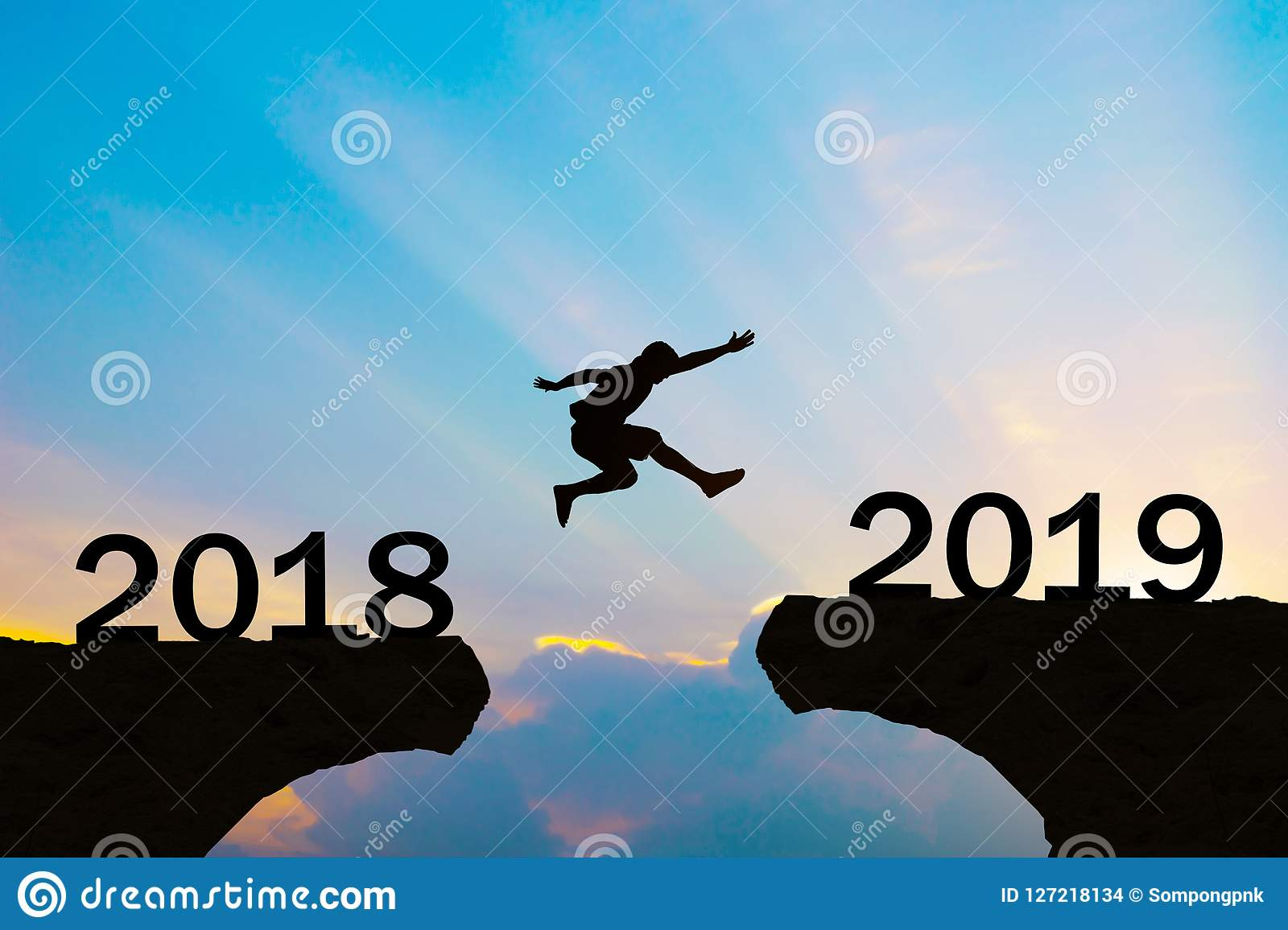 happy new year 2019 men jump over silhouette mountains