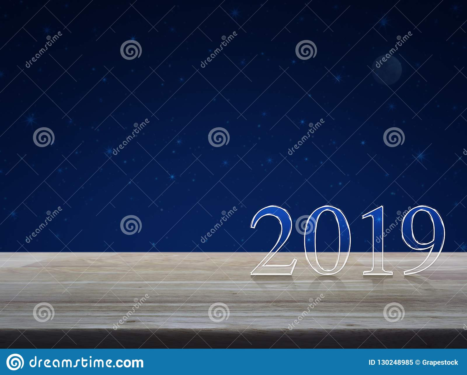 Happy new year 2019 text on wooden table