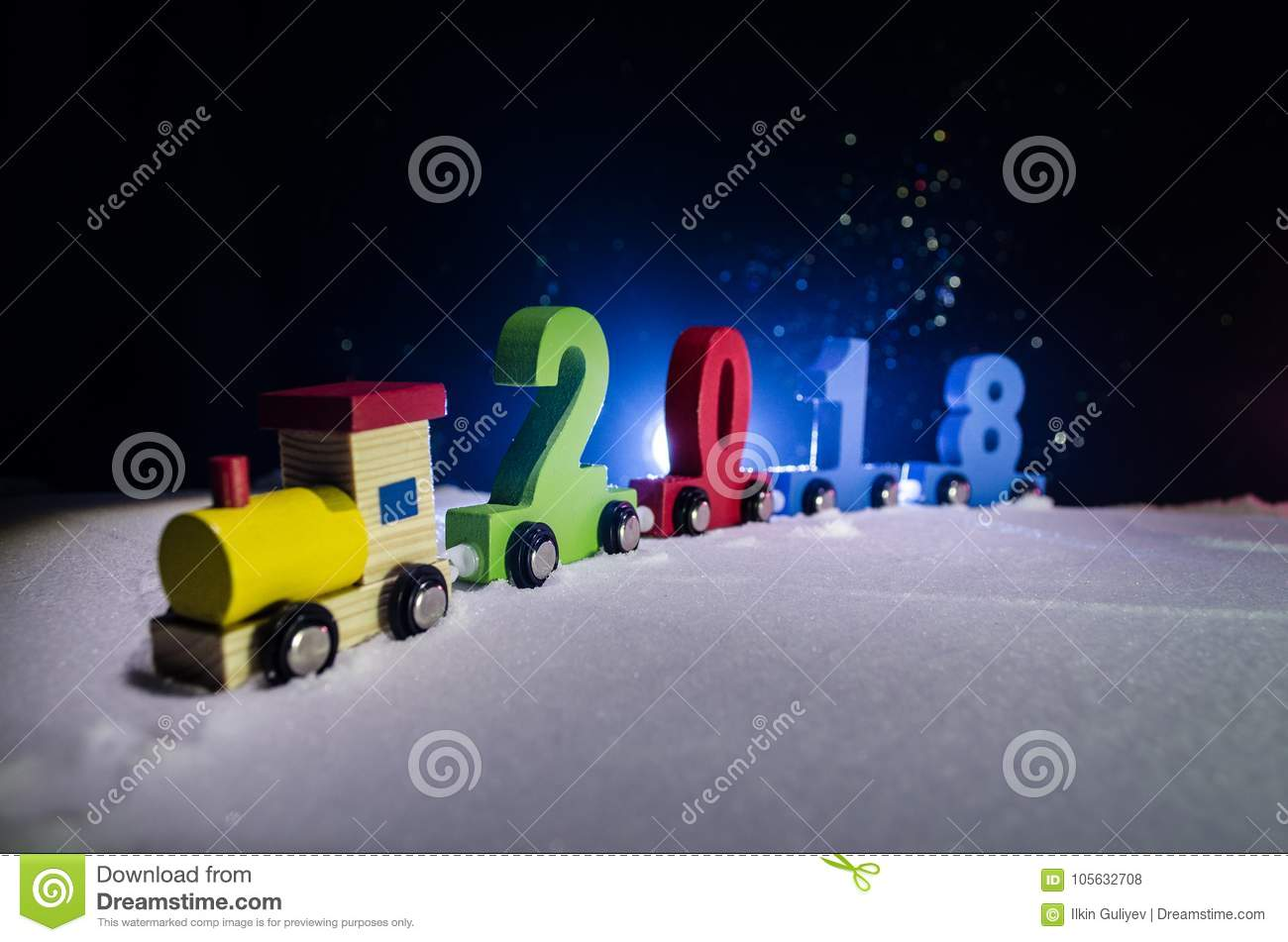2018 happy new year,wooden toy train carrying numbers of 2018 year on snow. Toy train with 2018. Copy space. Christmas decoration.