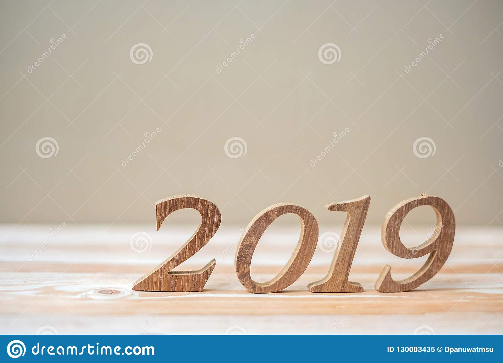 2019 Happy New years with brown wooden number on table and copy space. New Start, Resolution, Goals and Mission