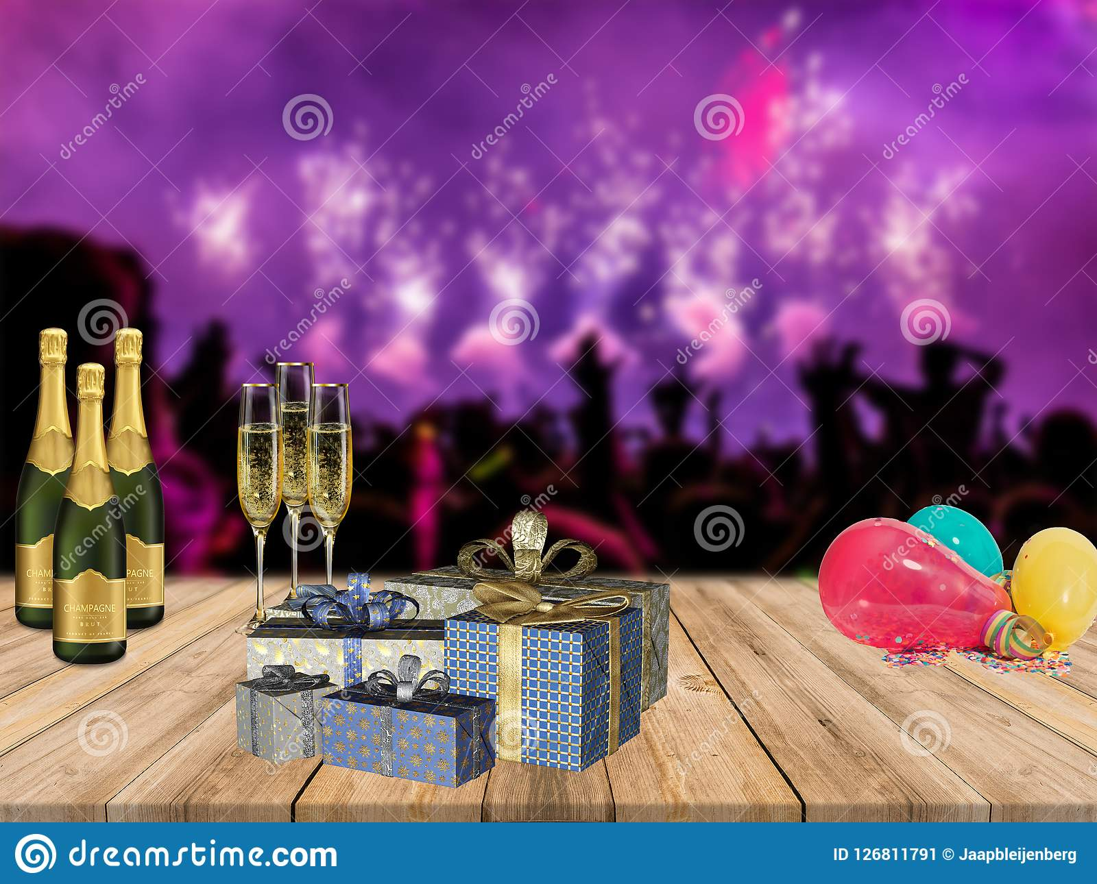 Happy new years party table with champagne presents and balloons with partying crowd and fireworks background