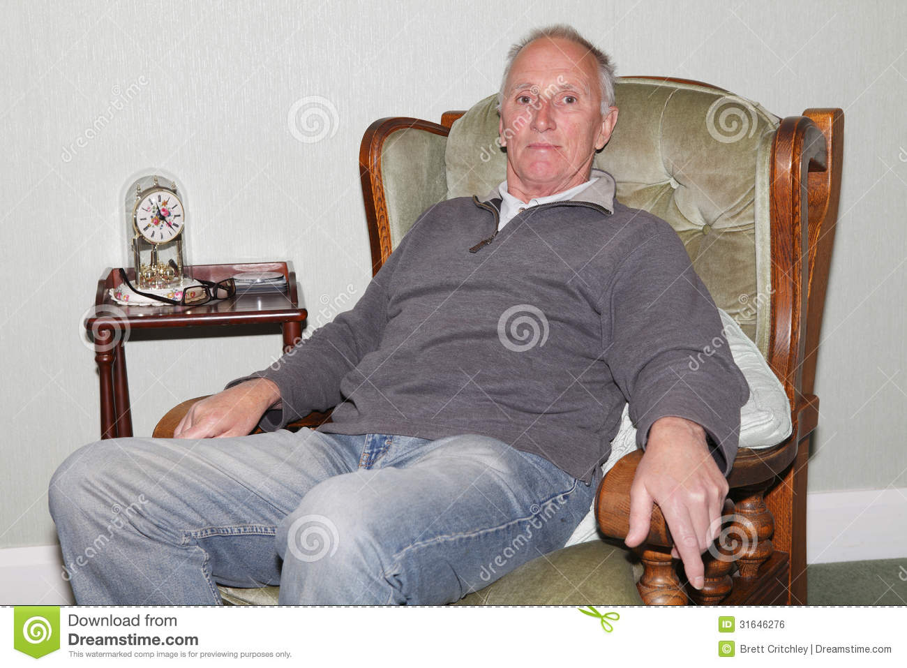 Happy old man sitting in his armchair royalty free stock for Sitting in armchair