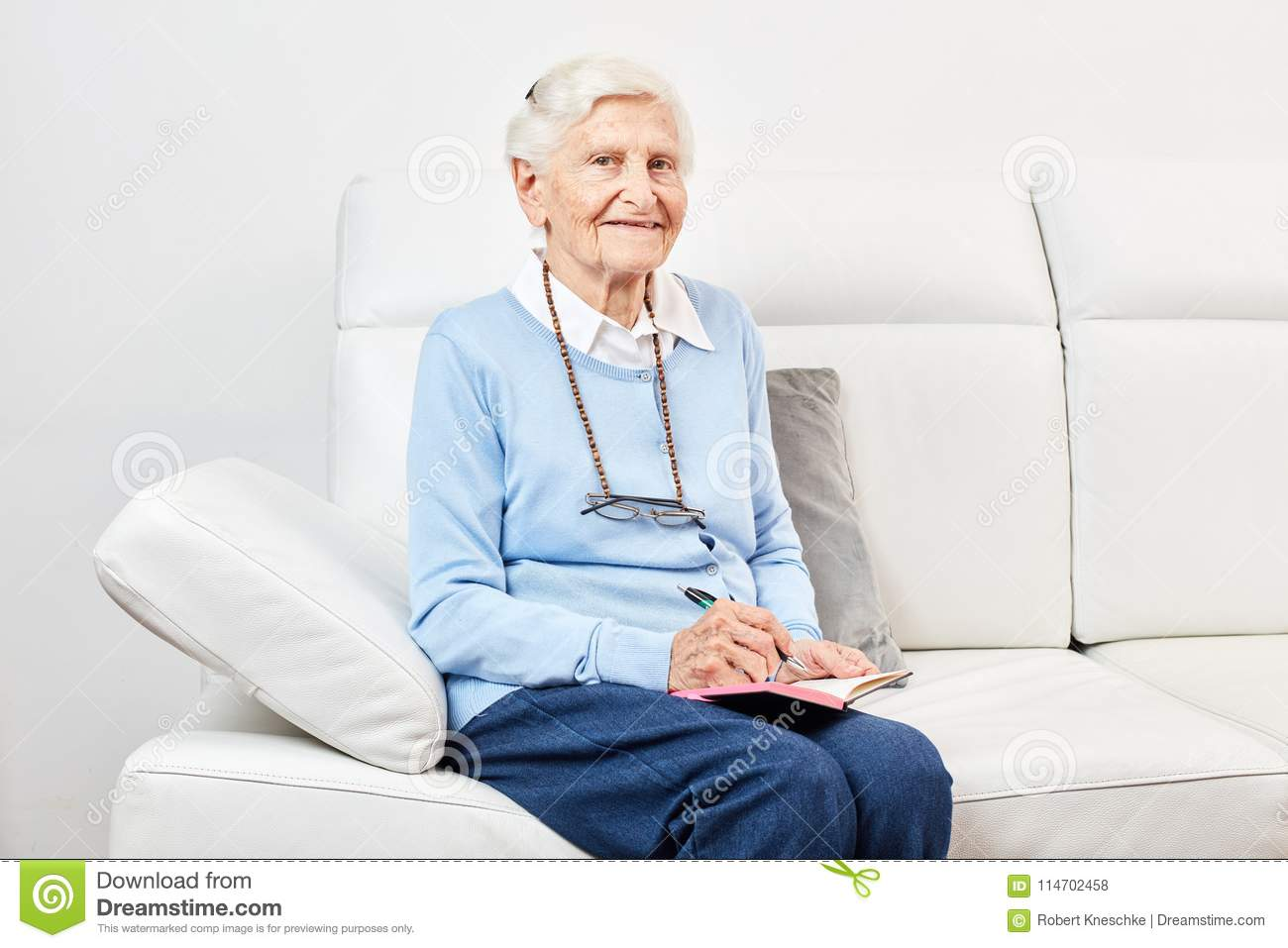 Happy Old Woman Is Sitting On The Sofa Stock Photo Image Of