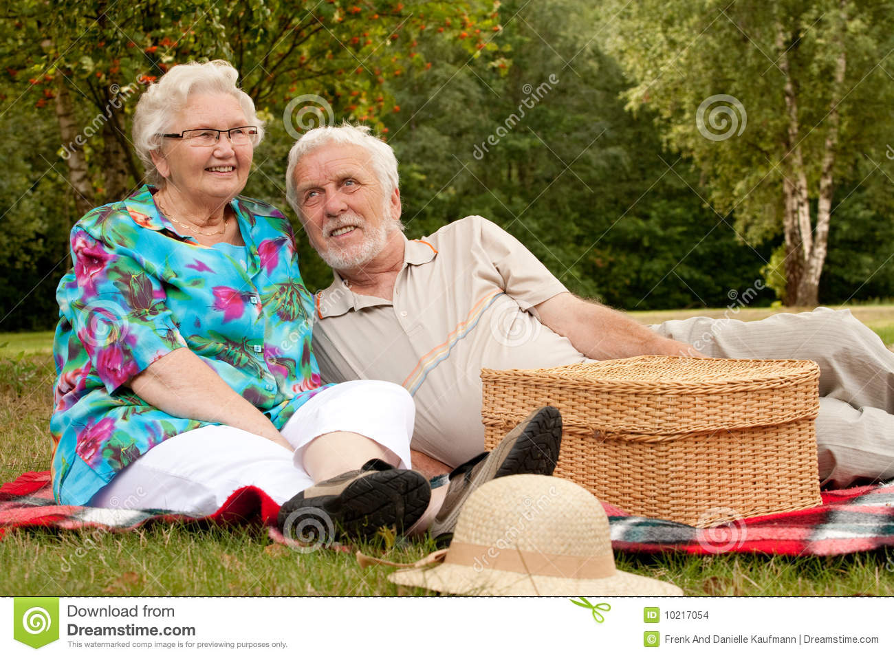 Happy older couple in the park