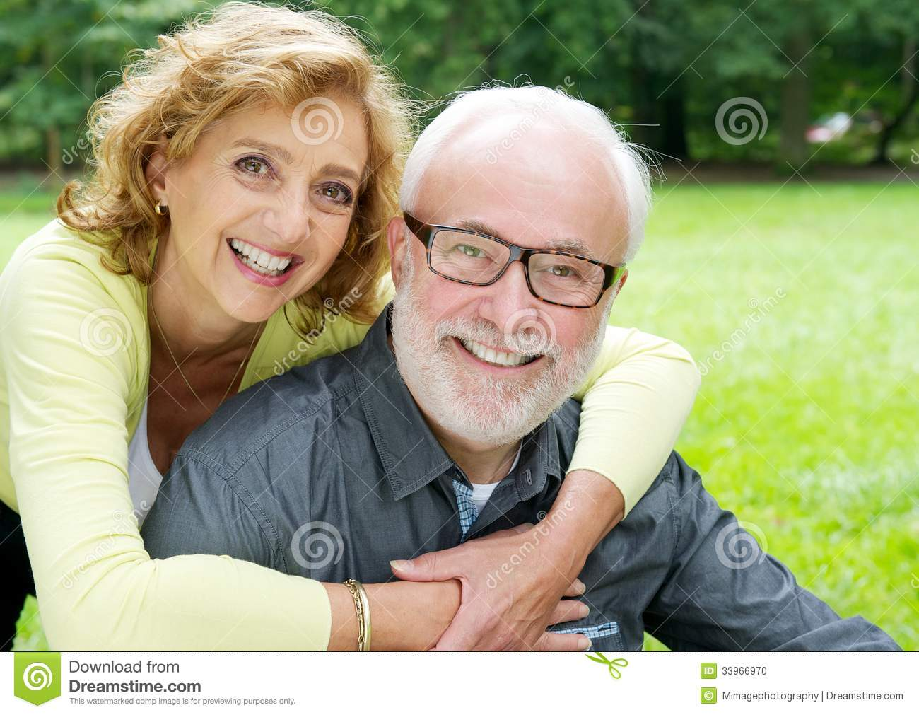 Happy Older Couple Smiling And Showing Affection Stock Photo
