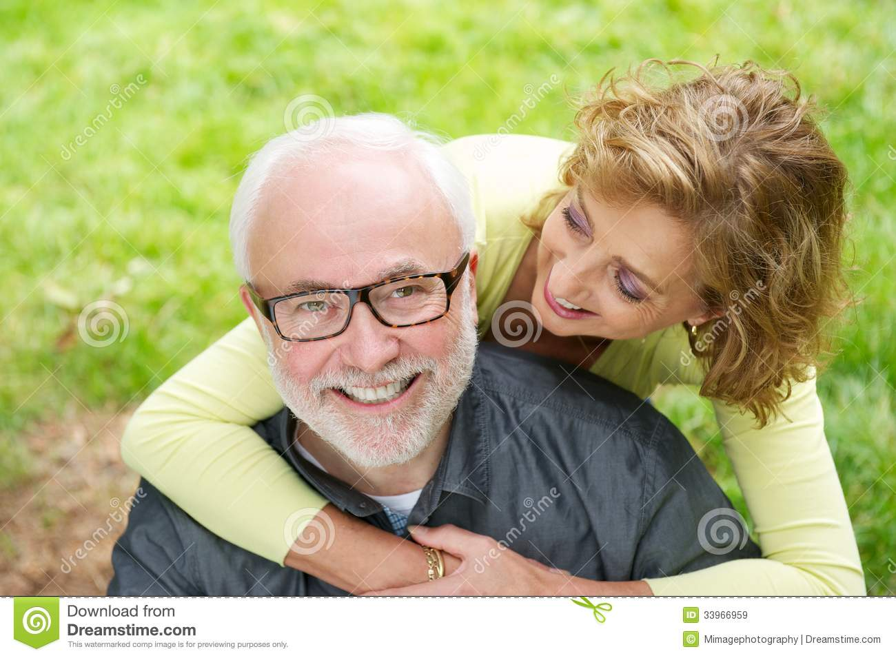 happy older man with beautiful woman smiling outdoors stock image