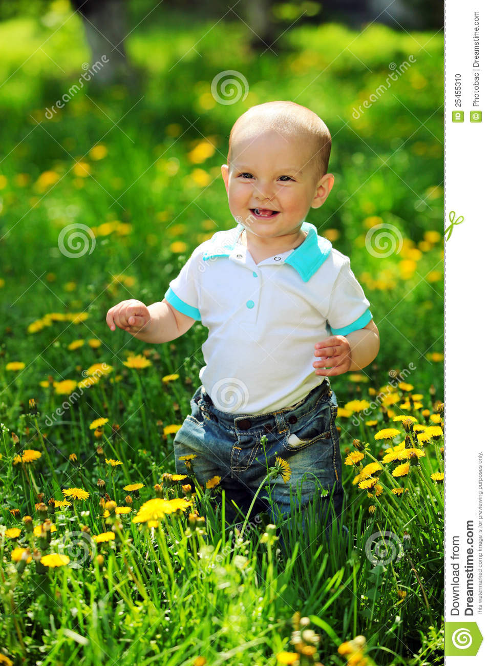 Happy One Year Old Boy On A Walk In A Park Stock Photo