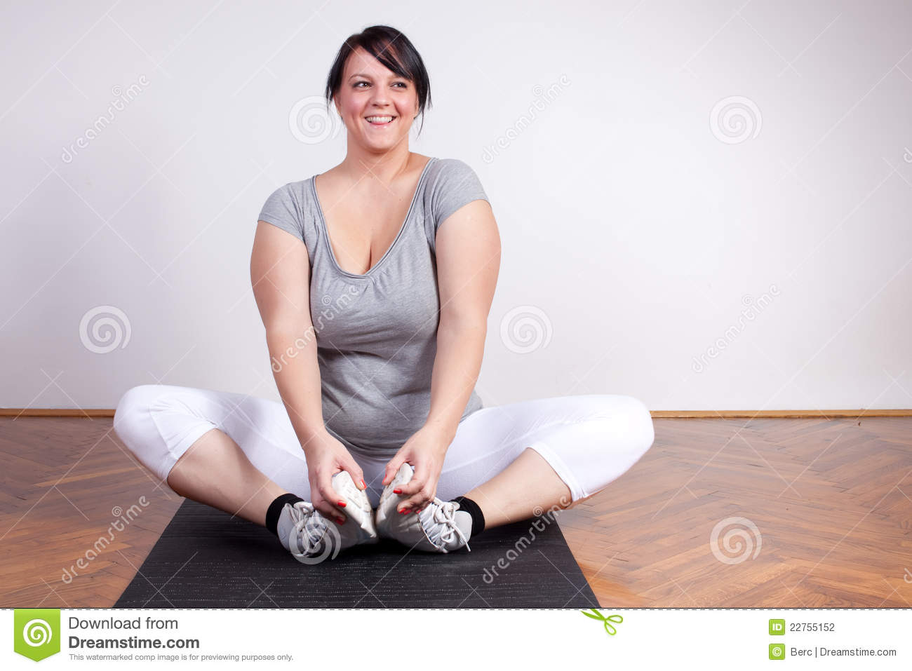 Happy Overweight Woman Exercising Stretching Stock