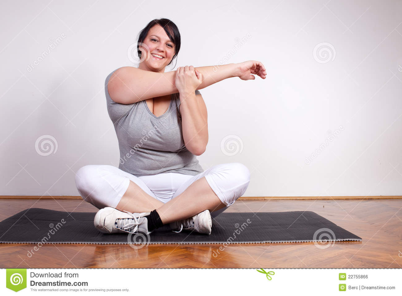 Happy Overweight Woman Exercising Stretching Royalty Free