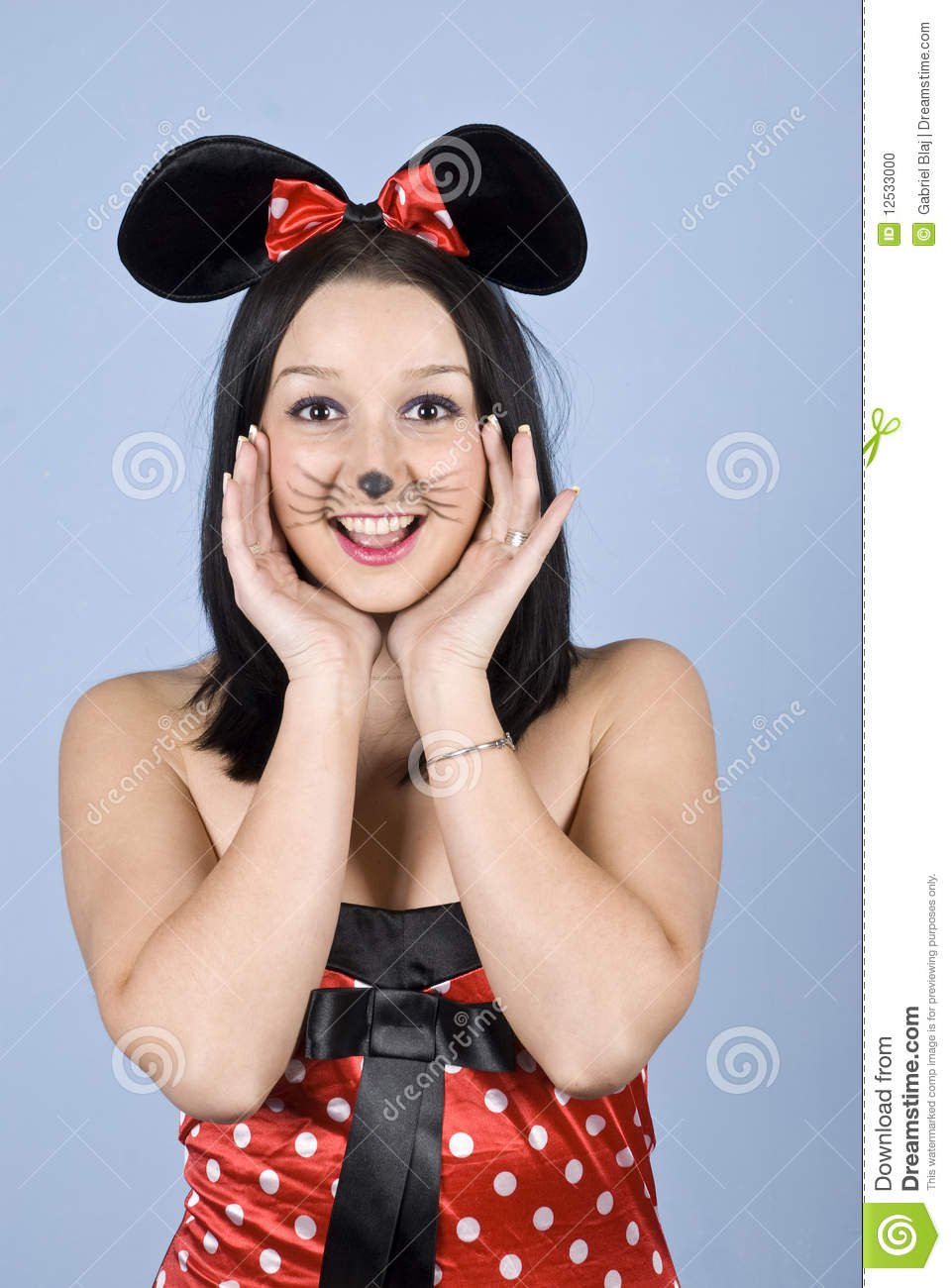 Happy girl with mouse costume and makeup holding hands to face and say:Hello!