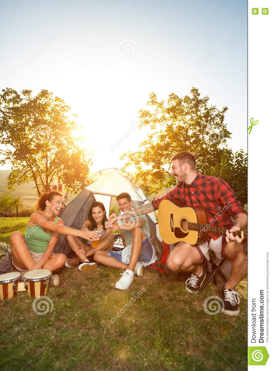 Happy people on camping trip drinking beer
