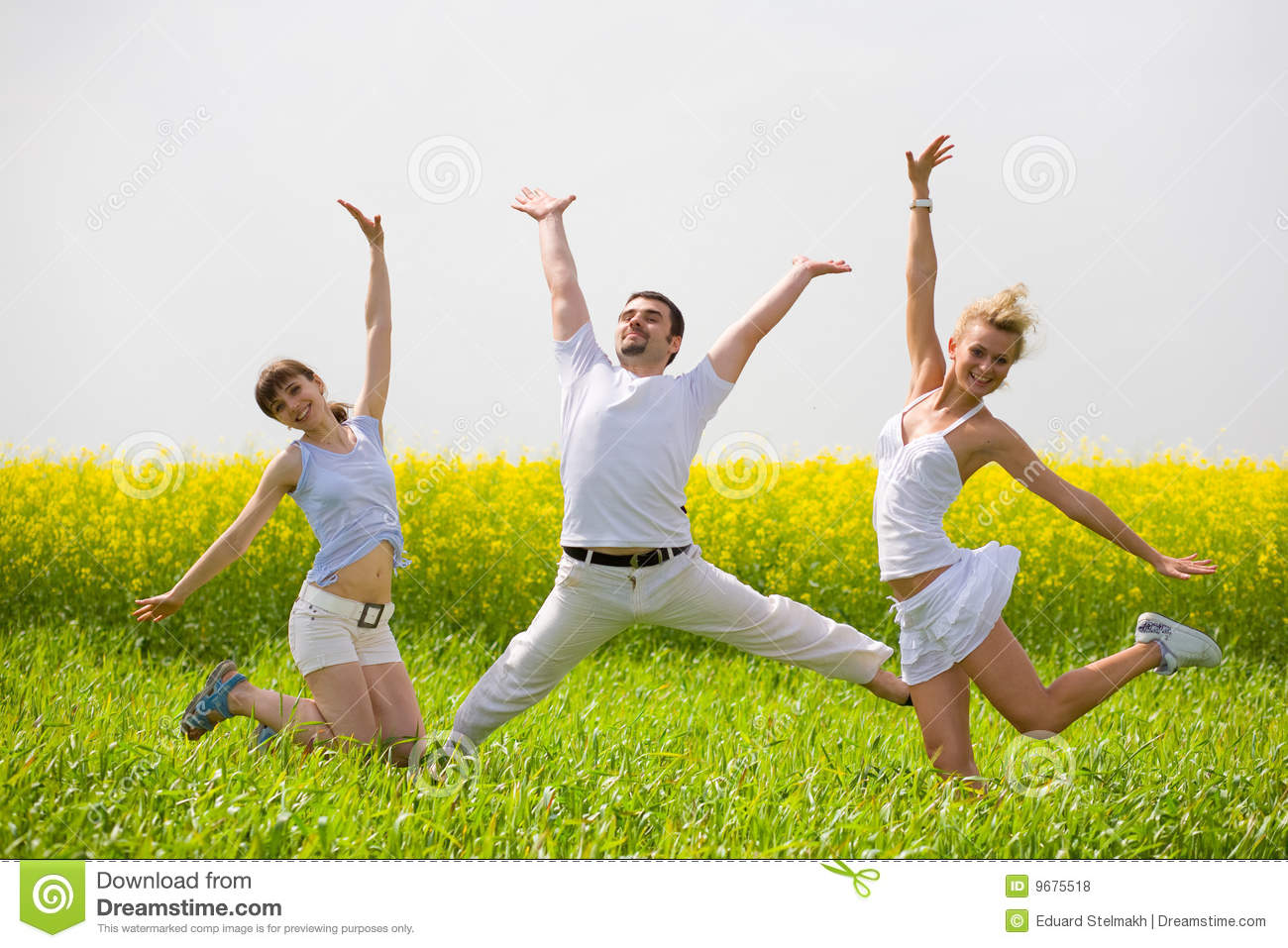 Happy People Is Jumping In Field Royalty Free Stock Photos