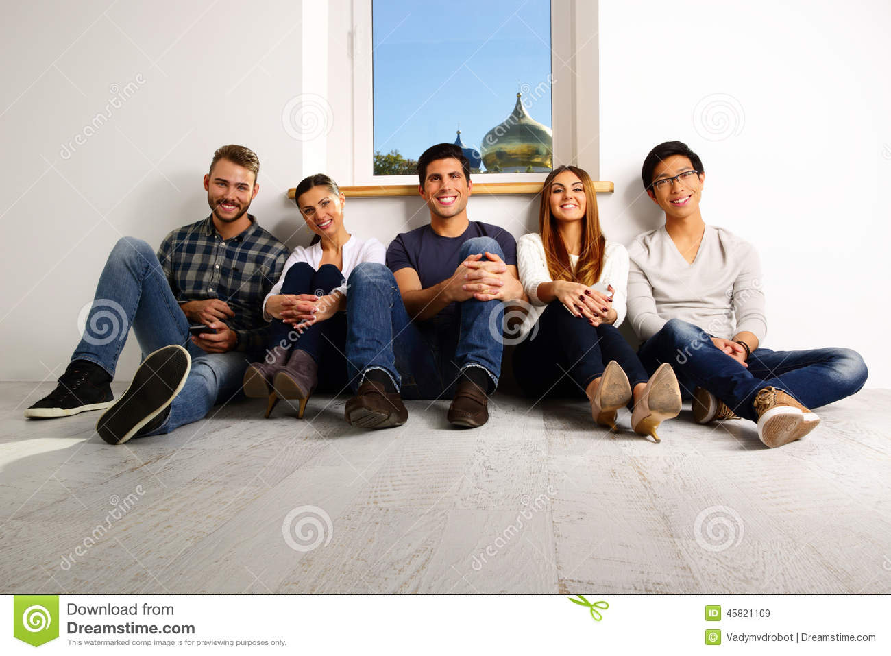 happy people sitting on the floor stock photo image
