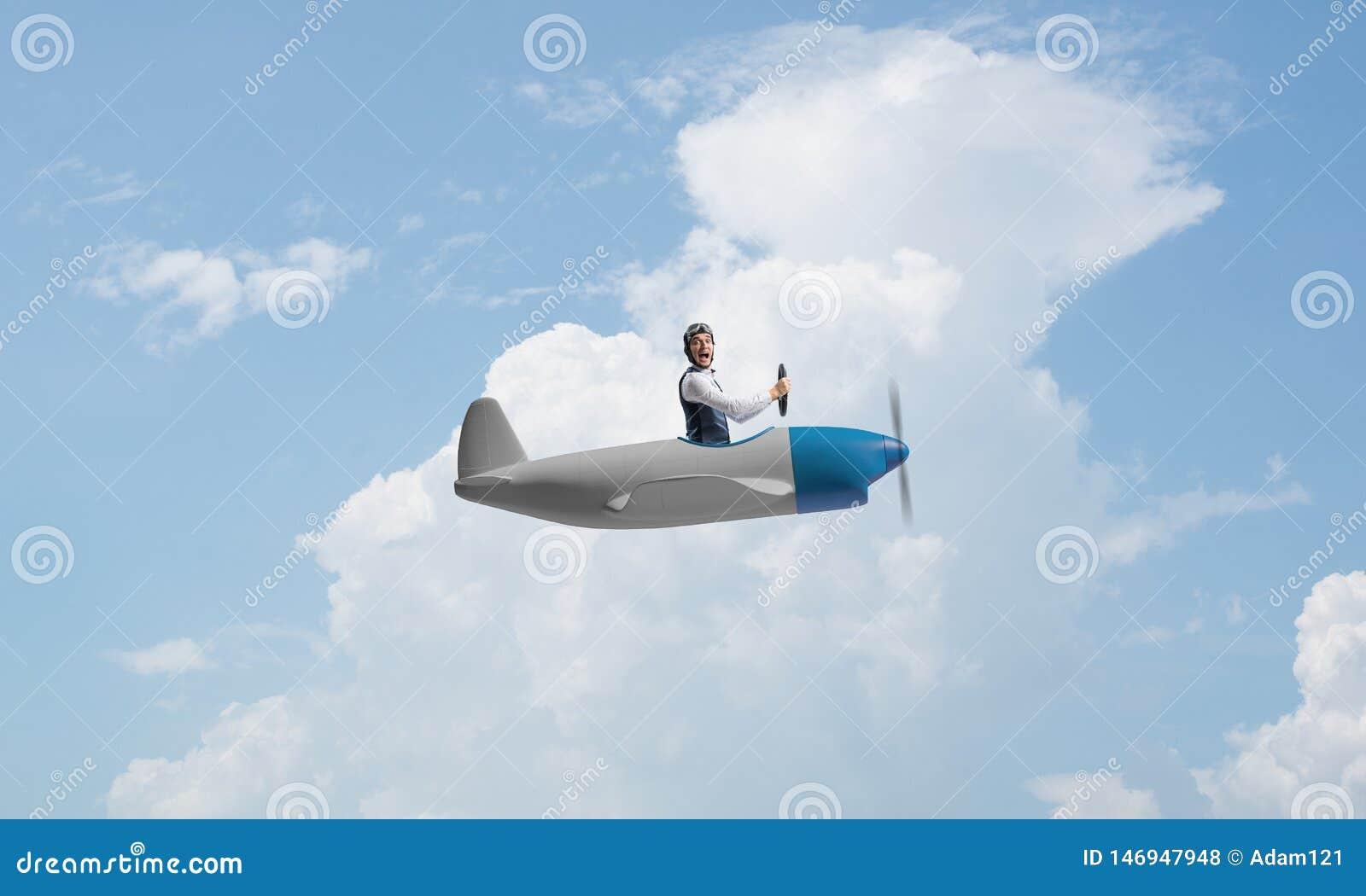 Happy pilot driving small propeller plane