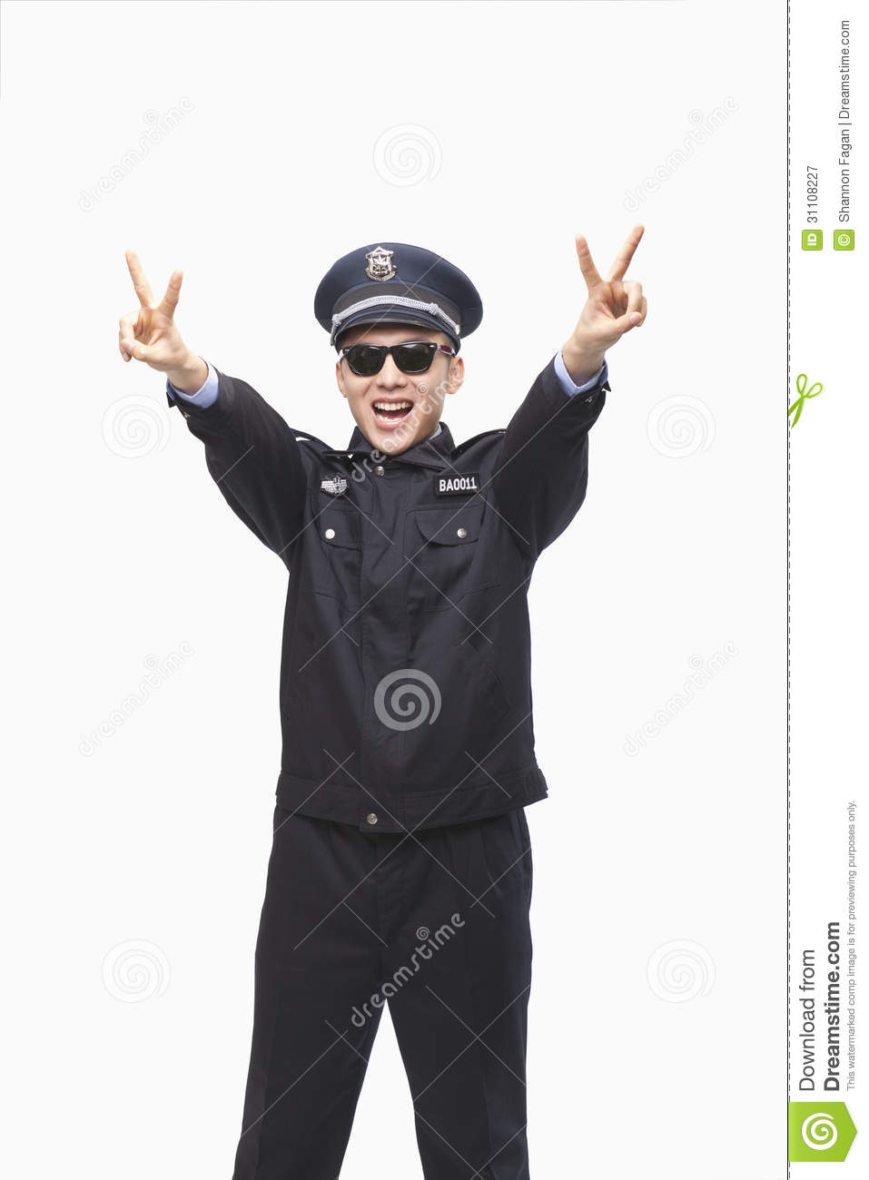 Royalty Free Stock Photography: Happy Police Officer Giving Peace Sign ...