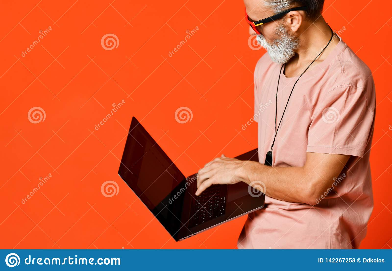 Happy portrait of trendy pensioner enjoying the use of new laptop