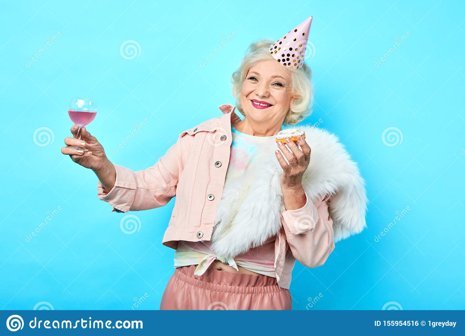 Happy positive funny senior woman having fun in the party