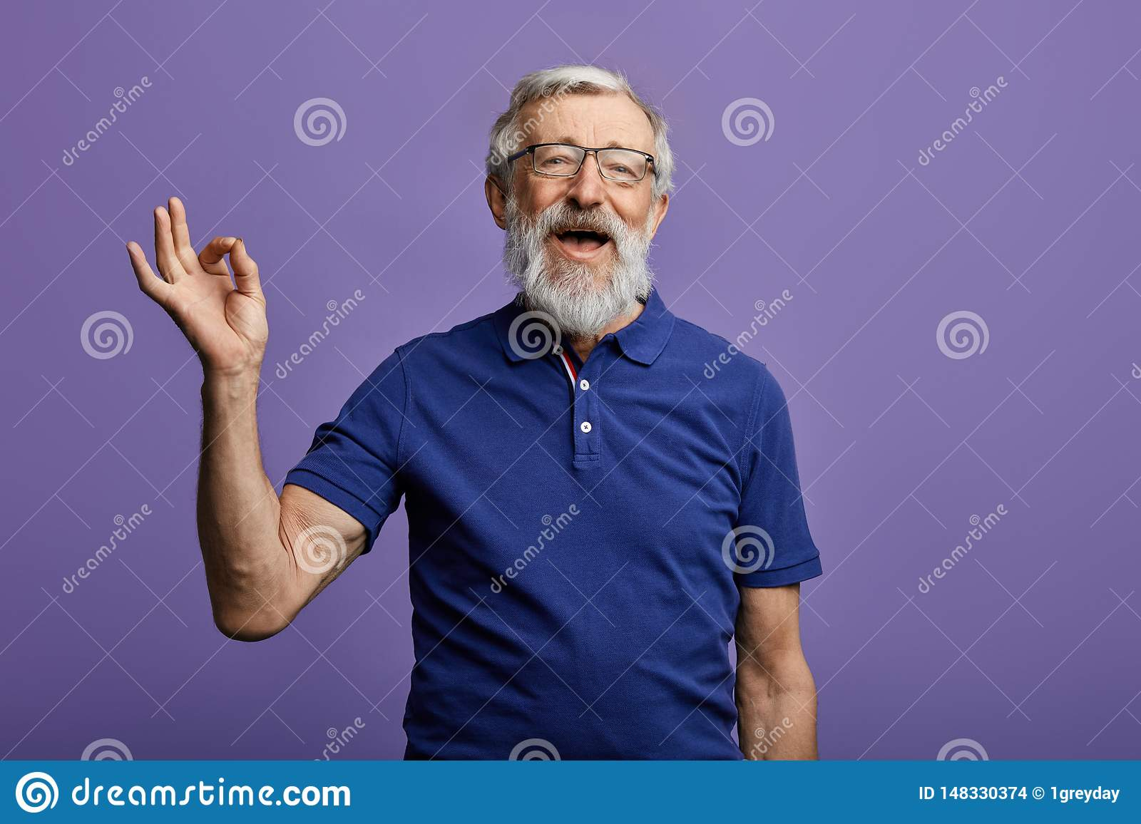 Happy positive handsome old man shows Ok sign, no problems, health is ok.