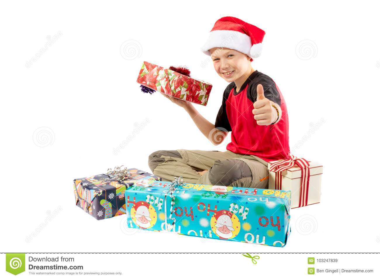 pre teen boy and a selection of christmas gifts