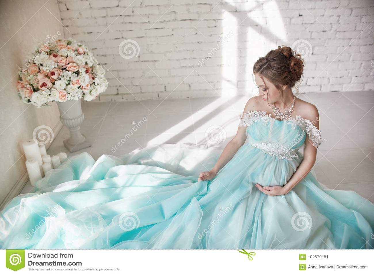 Happy Pregnant Woman In Long Evening Dress Touching Belly Hands ...