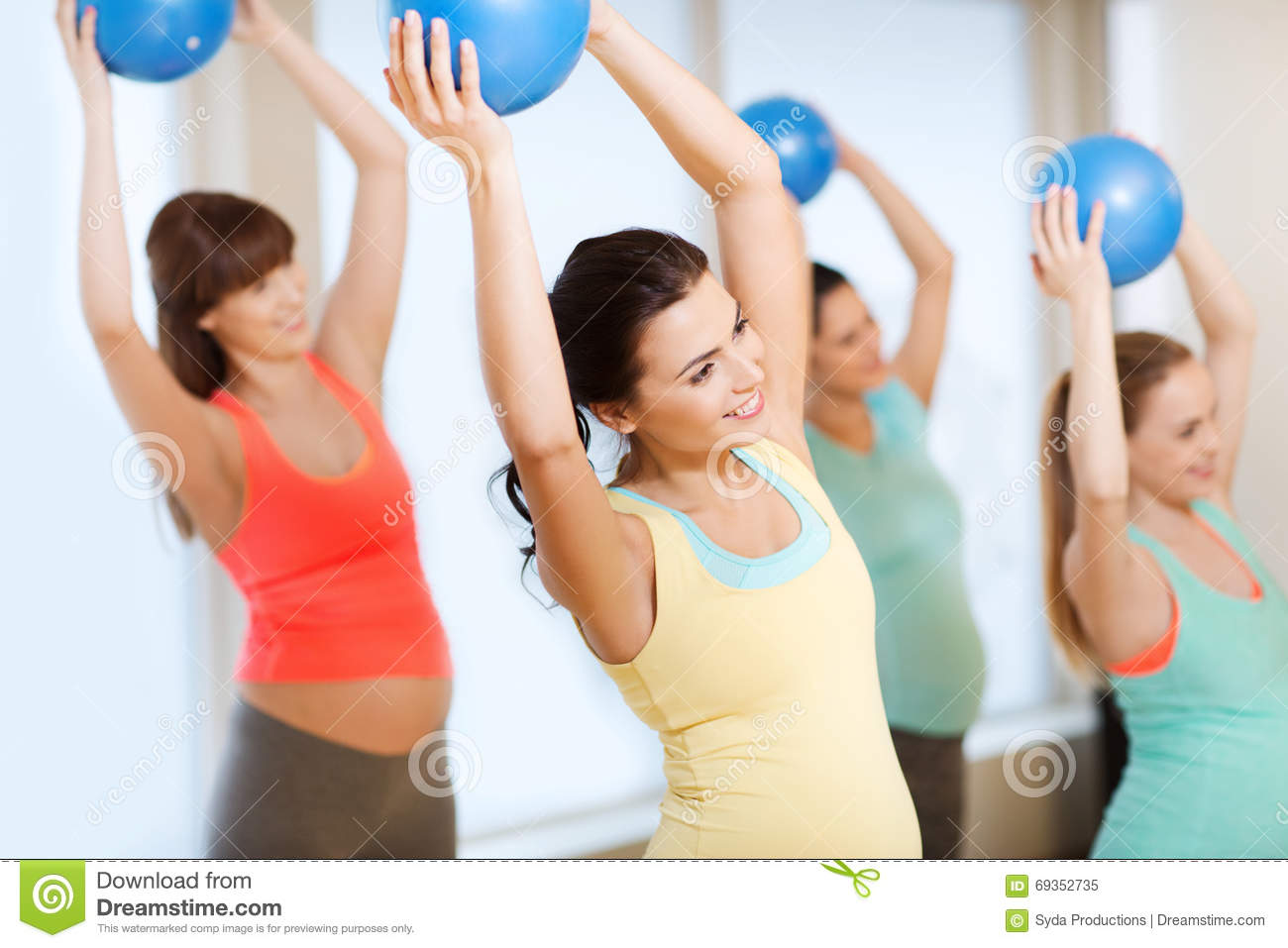 Happy Pregnant Women Exercising With Ball In Gym Stock ...