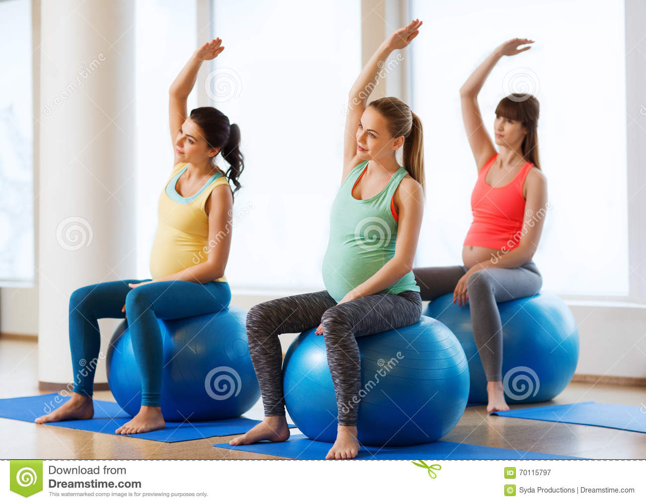 Happy Pregnant Women Exercising On Fitball In Gym Stock ...