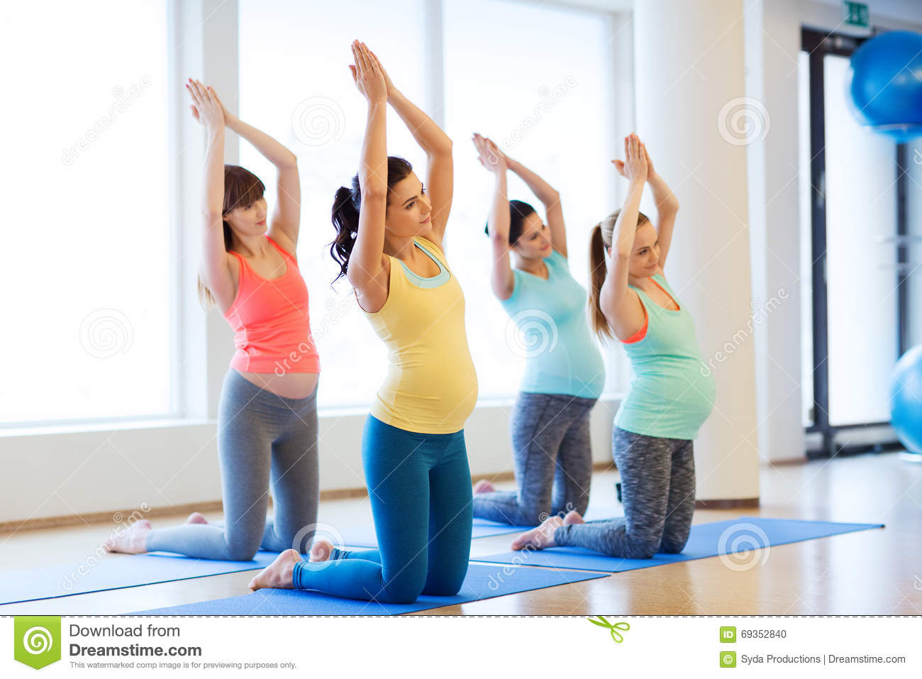 Happy Pregnant Women Exercising On Mats In Gym Stock Photo ...