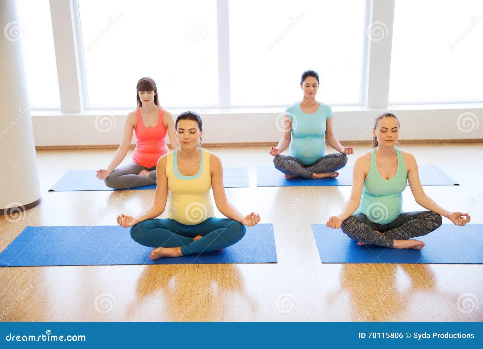 Happy Pregnant Women Exercising Yoga In Gym Stock Photo ...