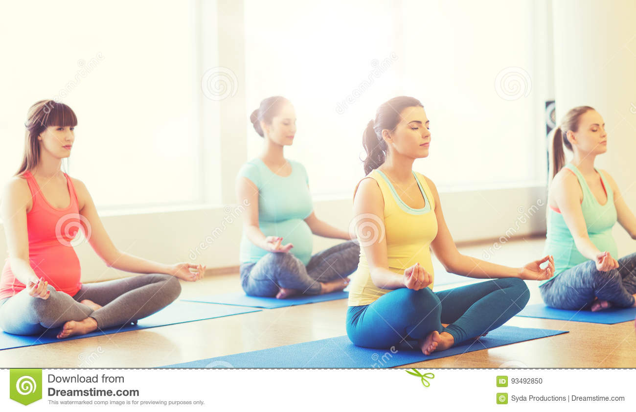 Happy Pregnant Women Exercising Yoga In Gym Stock Photo ...