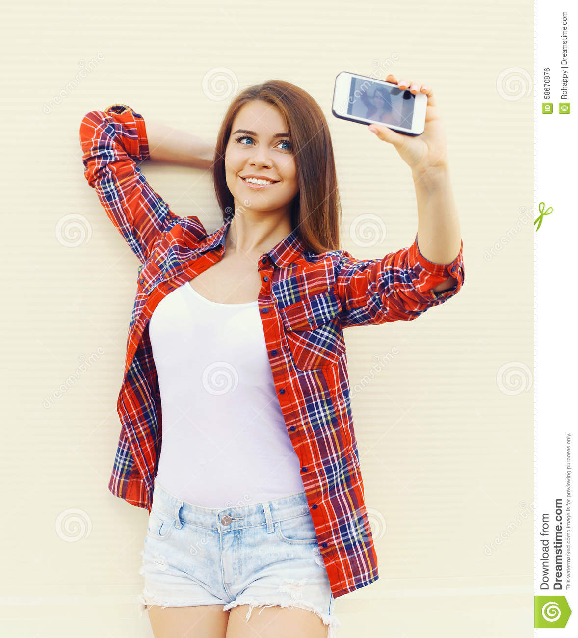 Happy Pretty Girl Wear A Checkered Red Shirt And Shorts Makes Self ...