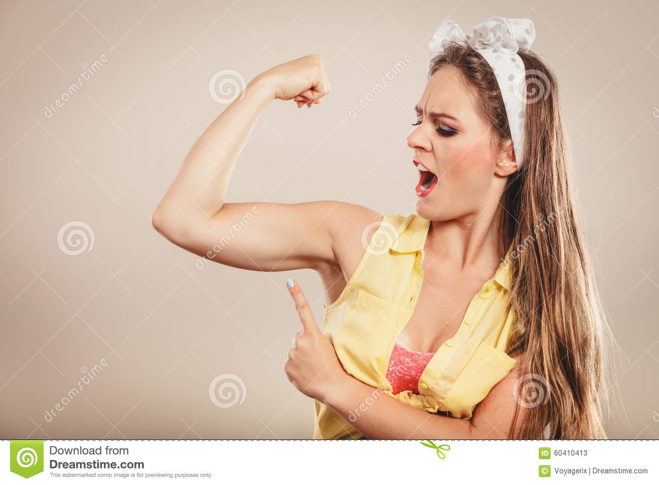 Young girls showing muscles