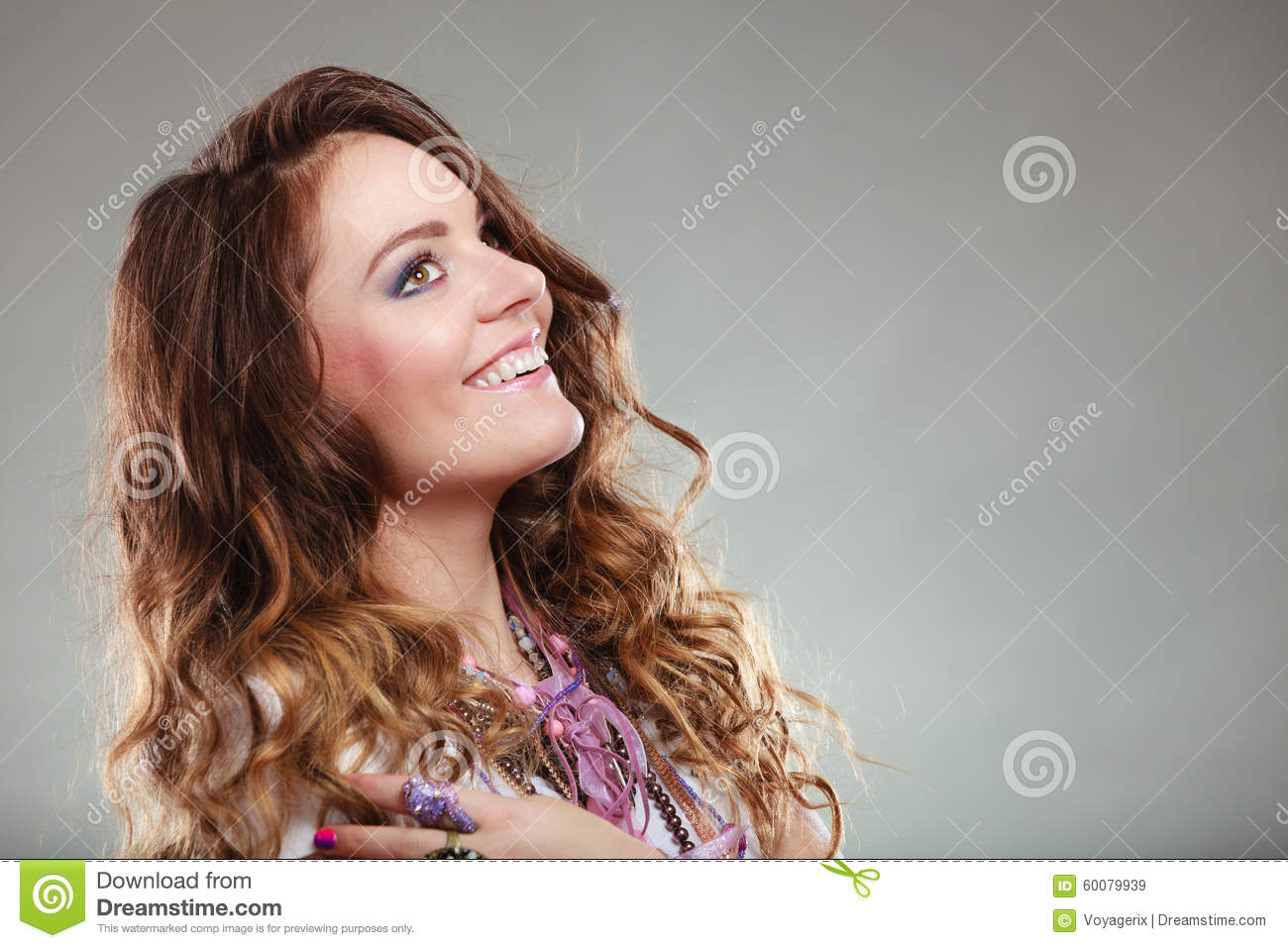 Happy pretty young woman wearing jewelry necklaces