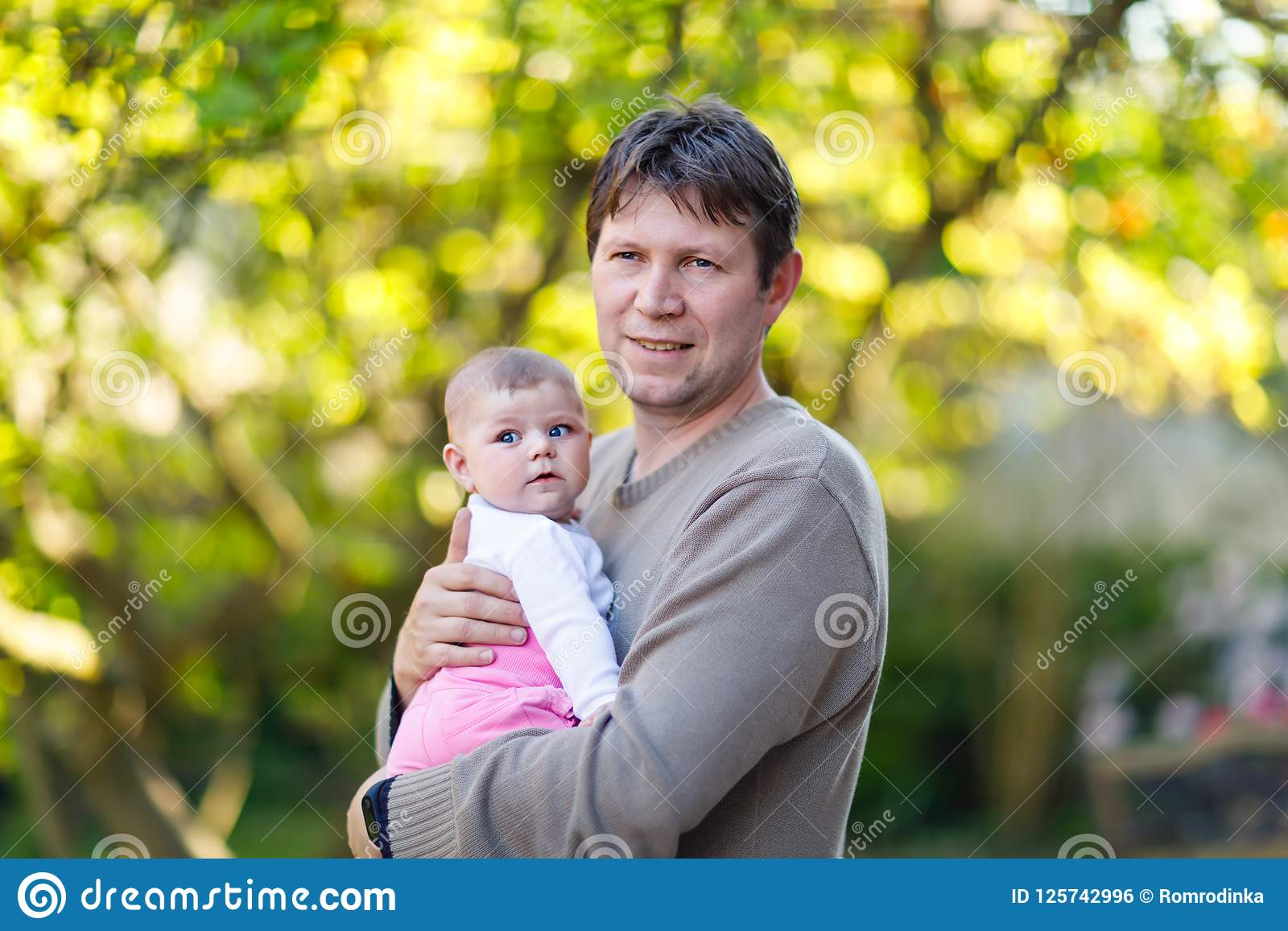 Very young little girl loves daddy