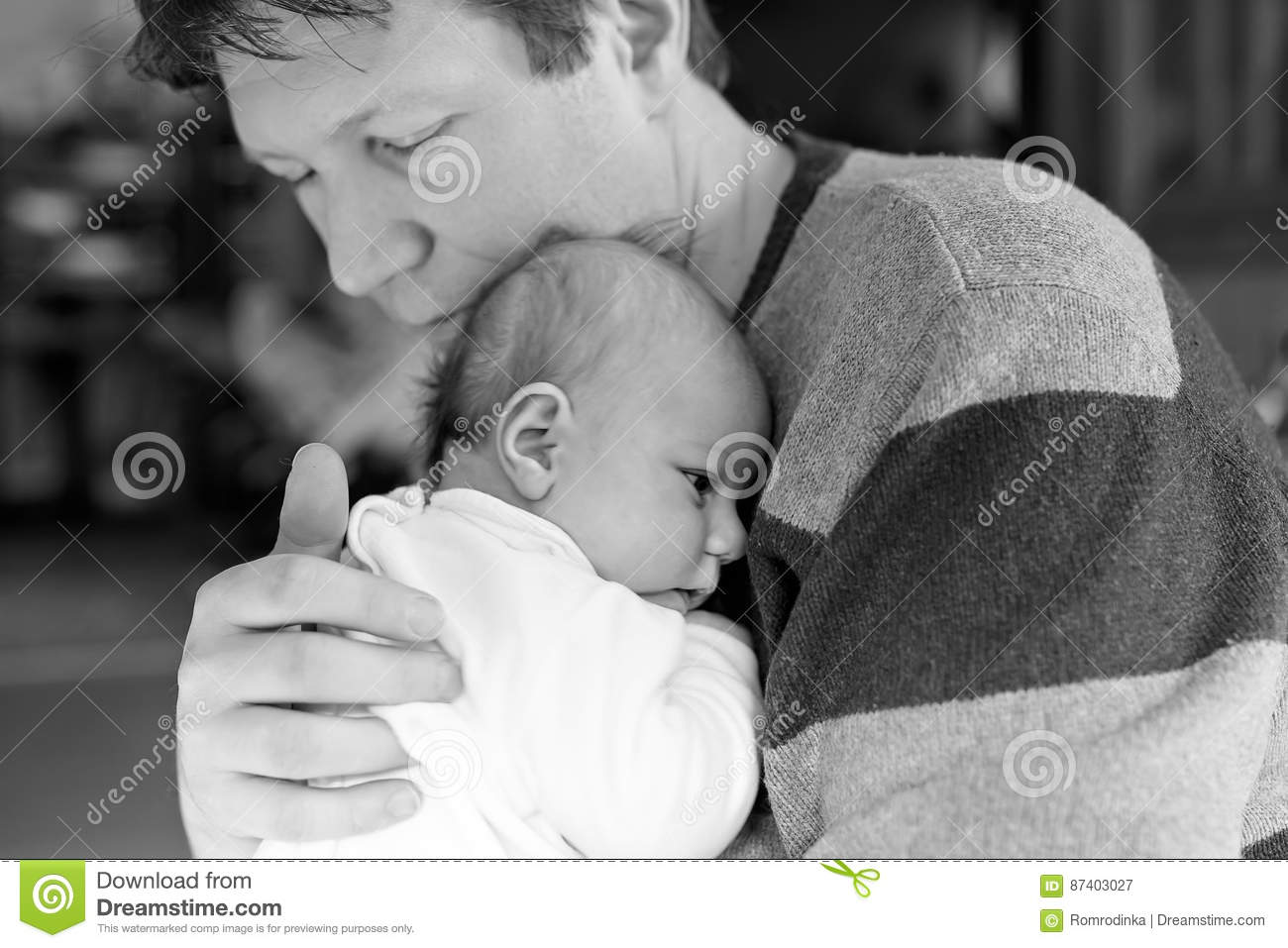 Happy proud young father with newborn baby daughter, family portrait togehter