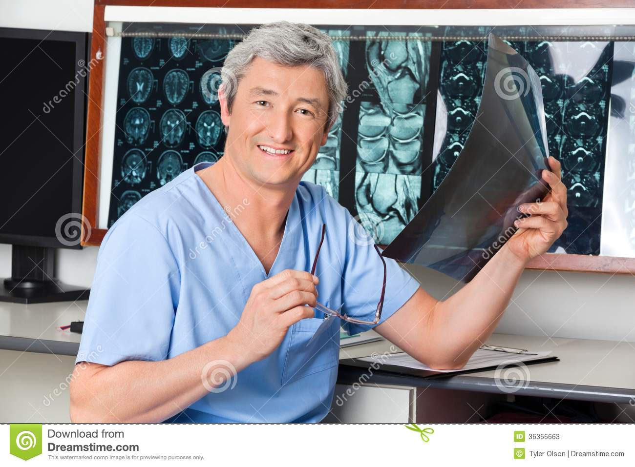 happy radiologist holding x-ray stock image - image of medical