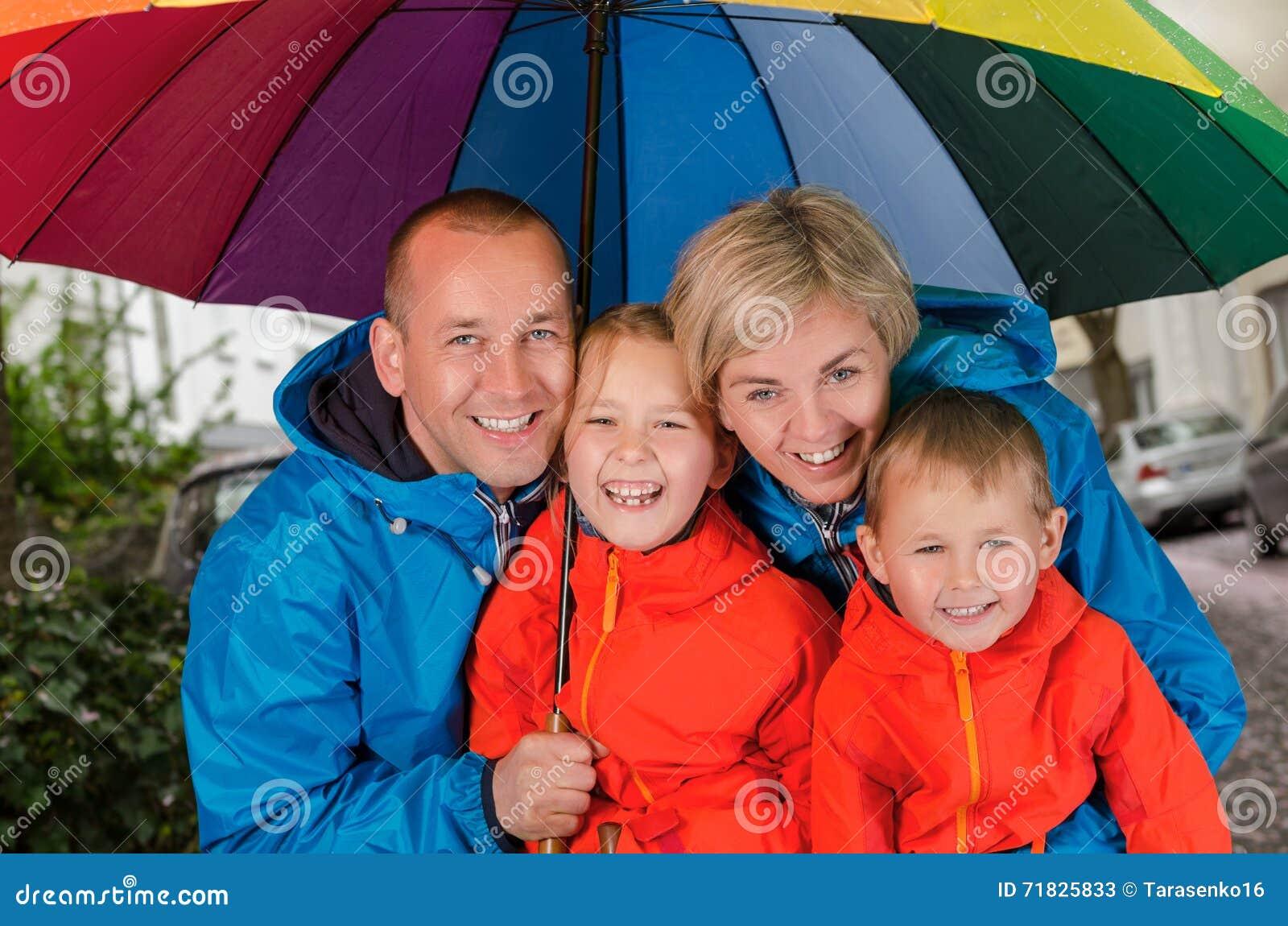 34400a11e5d2 Happy Rain Family Under Umbrella Stock Image - Image of under ...