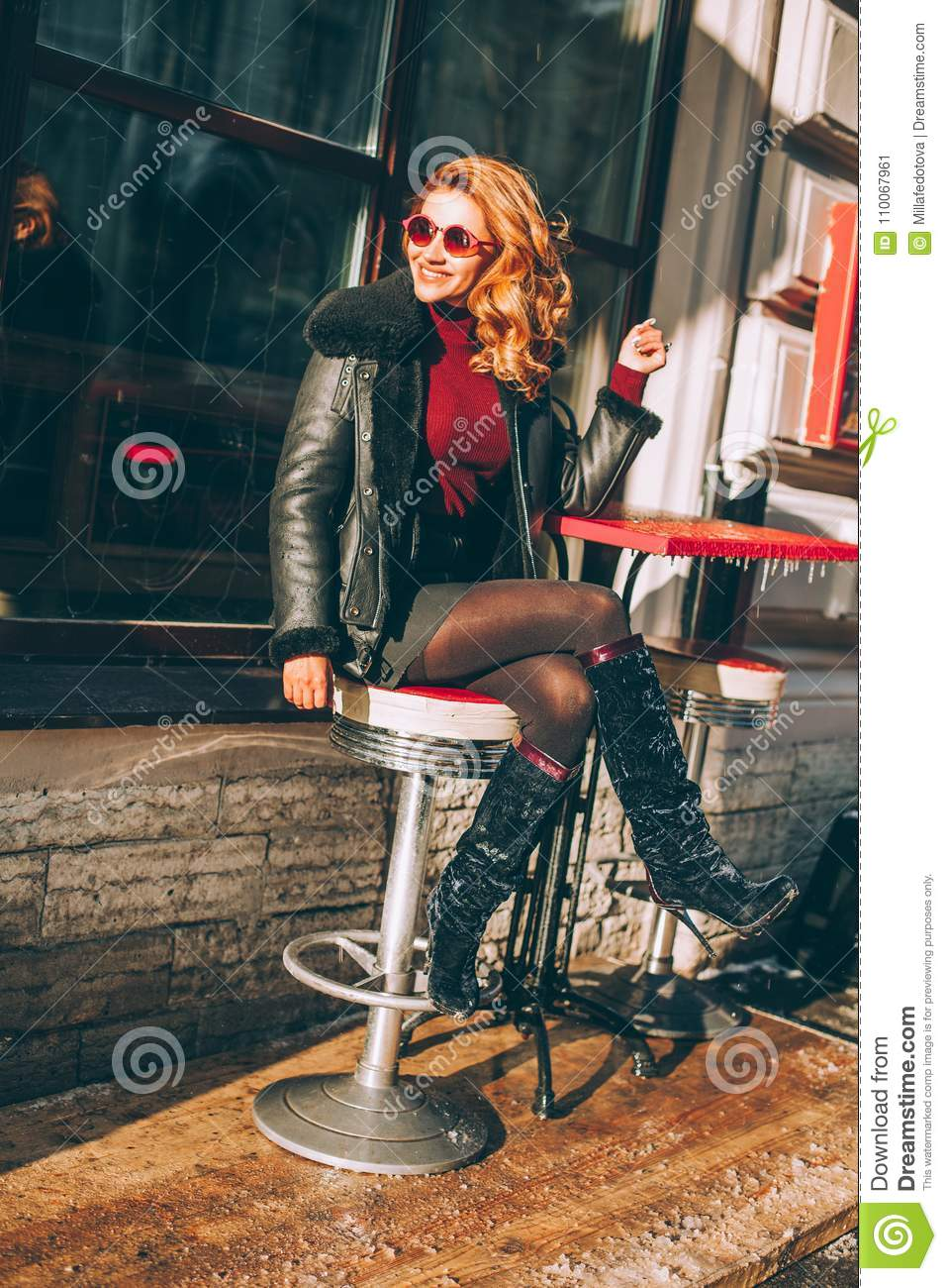 Happy Redhead Woman Laughing in Street Cafe