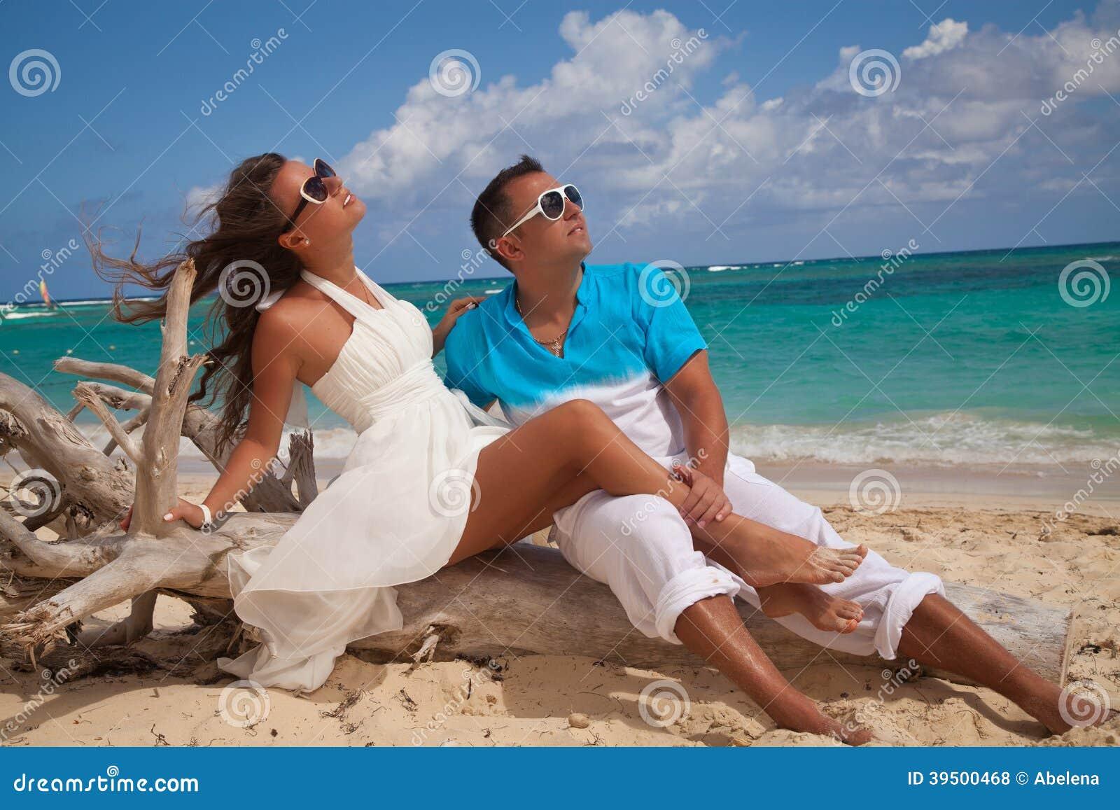 Happy Romantic Couple Enjoying Sunset at the Beach