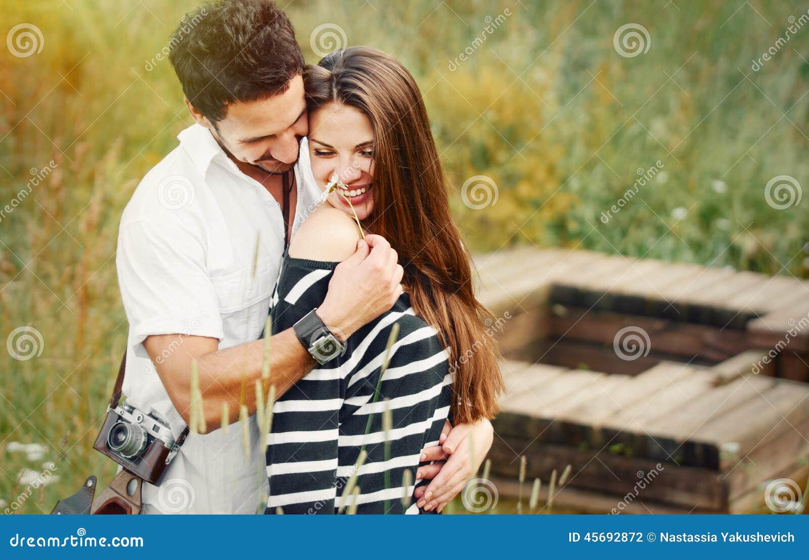 Happy Romantic Couple In Love And Having Fun With Daisy, Beauty Stock ...