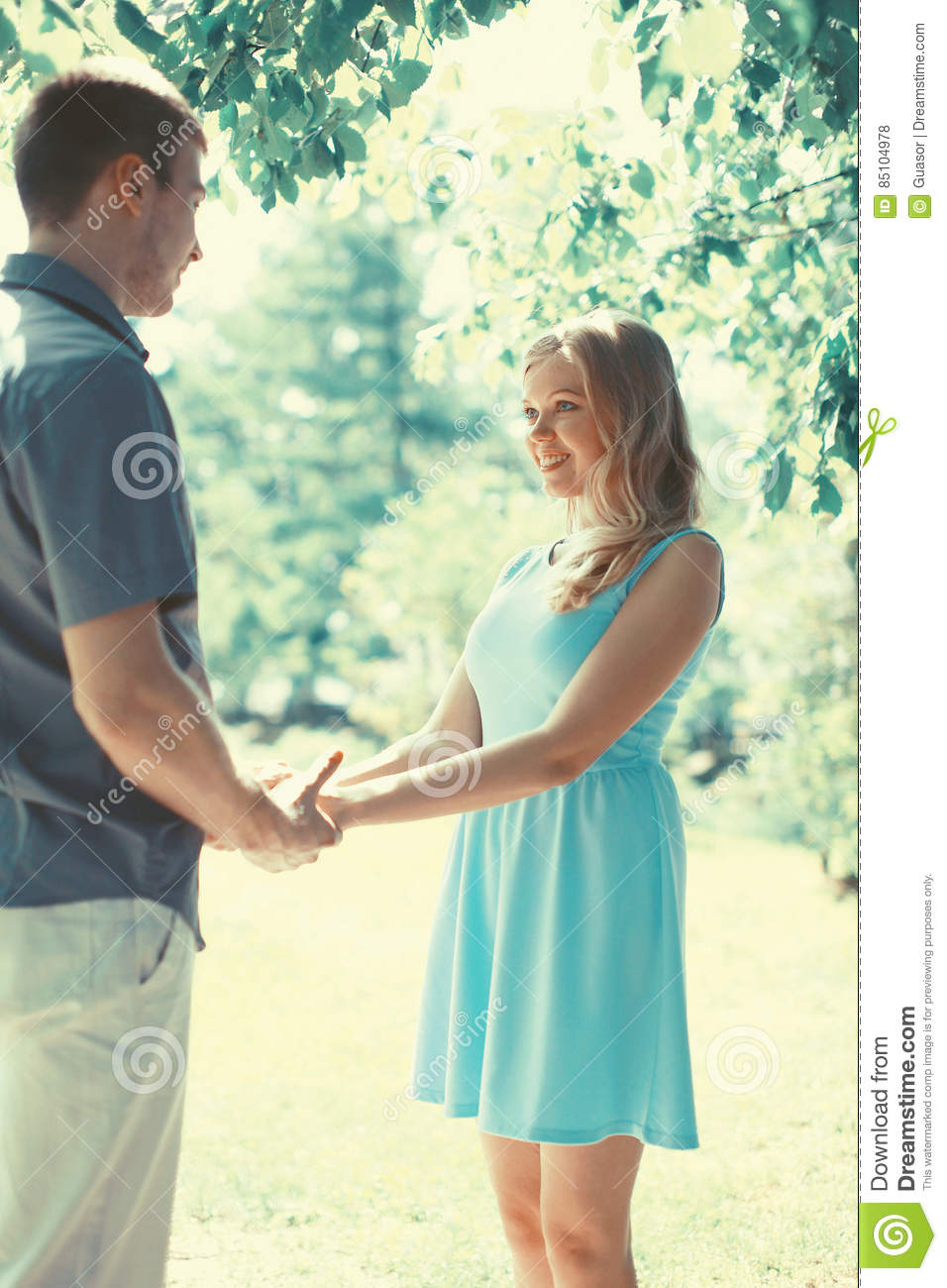 Happy romantic couple in love at warm sunny spring