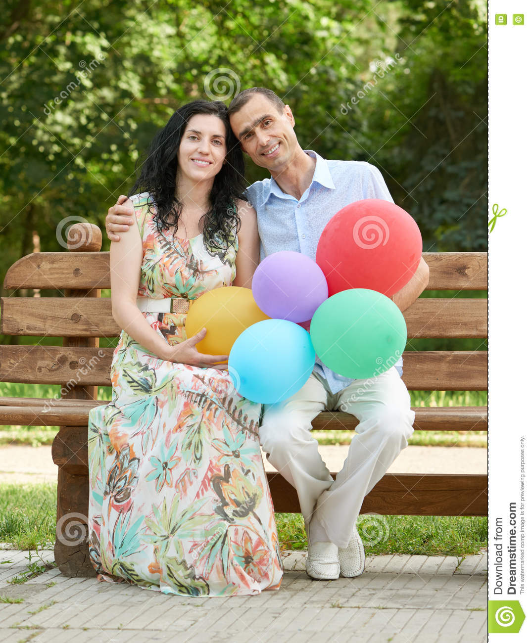 Download Happy Romantic Couple Sit On Bench In City Park And Posing Summer Season