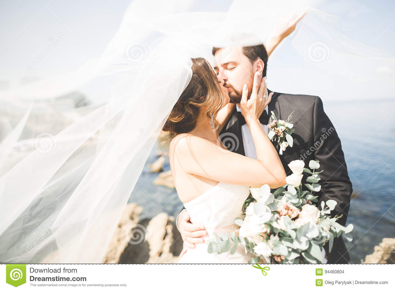 Happy And Romantic Scene Of Just Married Young Wedding Couple Posing On Beautiful Beach Stock Photo Image Of Outdoors Nature 94460804