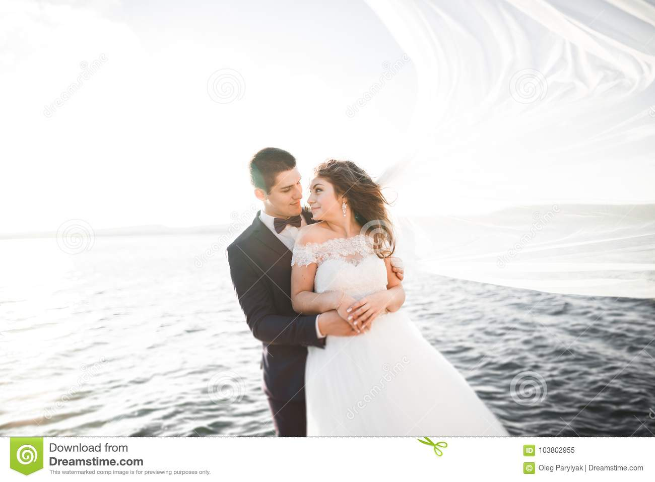 Happy And Romantic Scene Of Just Married Young Wedding Couple Posing On Beautiful Beach Stock Image Image Of Happy Female 103802955