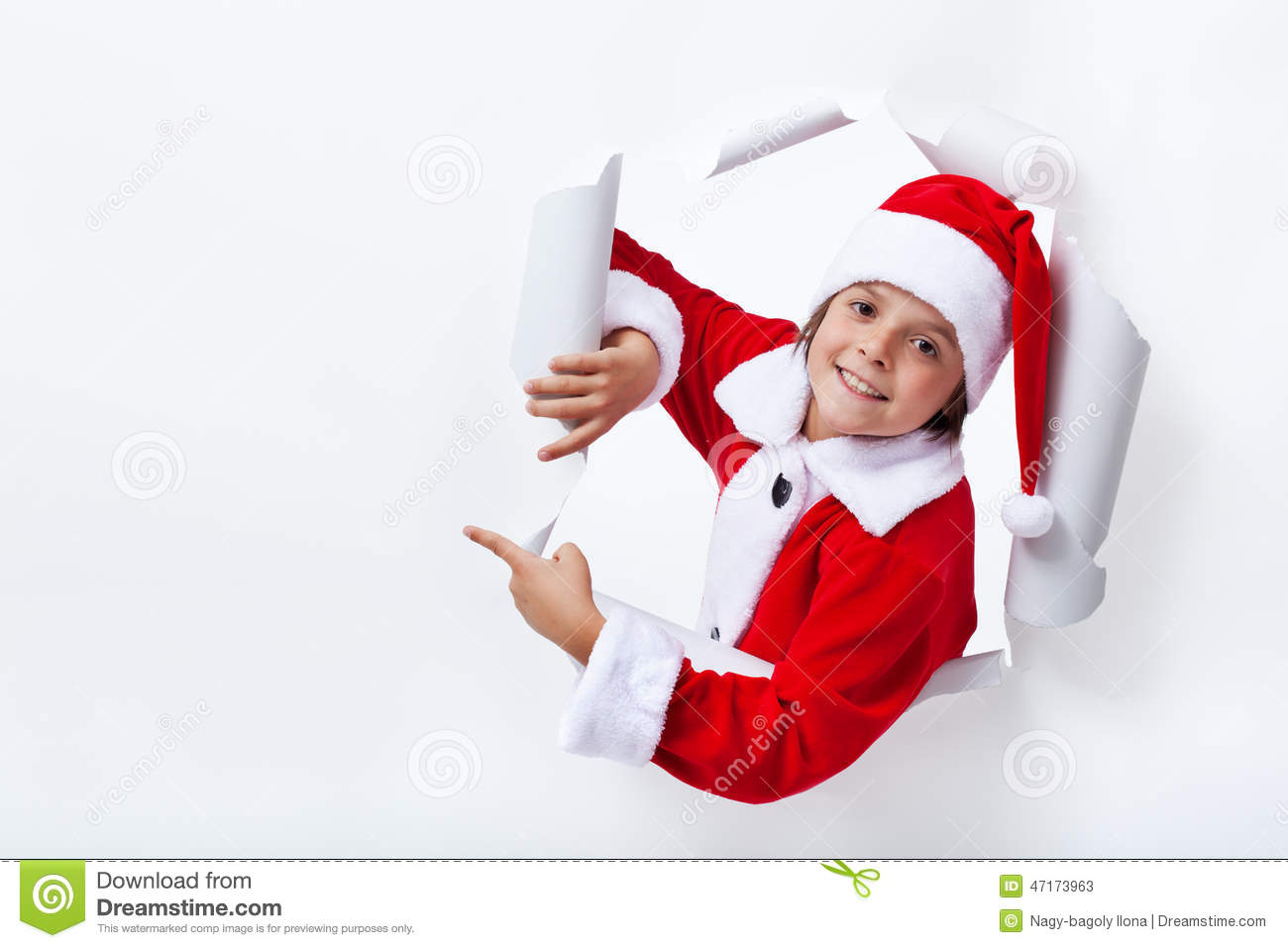 Claus costume boy pointing to copy space christmas advertising