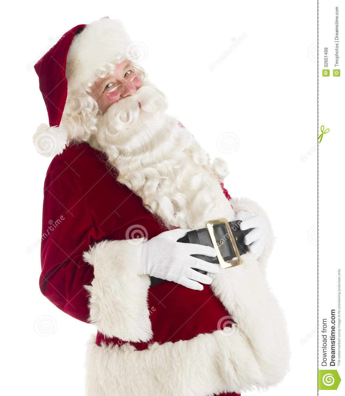 Portrait of happy Santa Claus with hands on stomach standing against ...