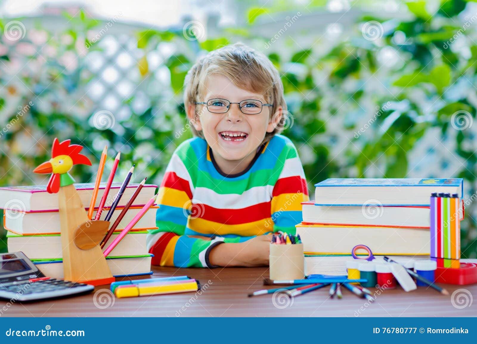 5f25ec23df86 Happy School Kid Boy With Glasses And Student Stuff Stock Image ...