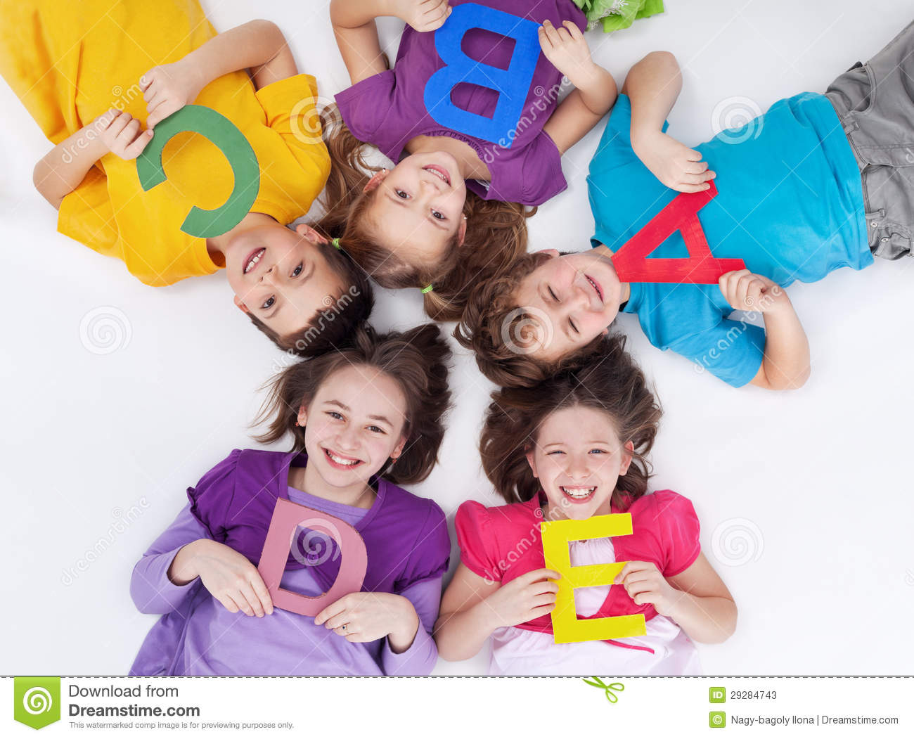 happy school kids with colorful alphabet letters stock photos - Kids School Pics